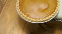 Cooking Mitt Sets Hot Pumpkin Pie On Counter To Cool  - stock footage