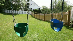 Empty swings in a backyard Stock Footage