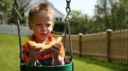 Boy eating melon Stock Footage