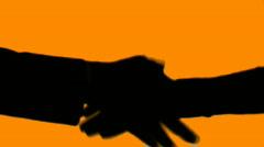 Business handshake silhouette - orange - stock footage