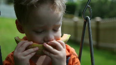 Boy eating melon - stock footage