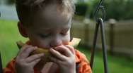 Boy eating melon Stock Footage