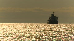Ship in harbor, sun reflecting off water Stock Footage