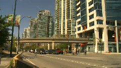 Traffic, skytrain and condos Stock Footage