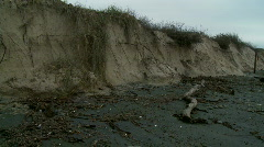 Beach Erosion - Storm Damage, Sand Dunes, Panned Back and Forth Stock Footage