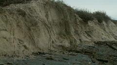 Beach Erosion - Storm Damage, Sand Dunes, Debris, Panned, Tilt Stock Footage