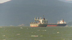 Marine transportation, cargo ships, windy afternoon Stock Footage