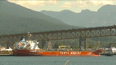 Traffic over bridge and ship Stock Footage