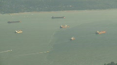 Burrard inlet cargo ships, #2 zoom back Stock Footage