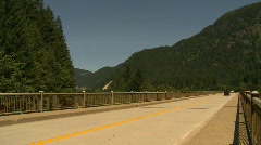 Holiday traffic, motorhome over bridge Stock Footage