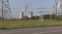 Biker Rides by Power Plant Stock Footage