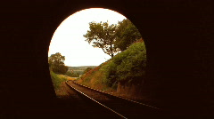 Steam train leaving tunnel Stock Footage