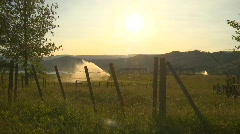 agriculture, irrigation in farm field evening, barb wire, #4 - stock footage