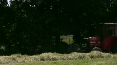 Hay harvest, cows in background Stock Footage