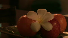 Oranges and Apple with Flower Stock Footage