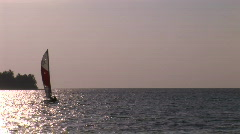 Sailboat in evening light Stock Footage