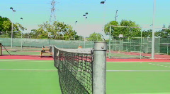 Tennis balls over net Stock Footage