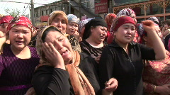 Xinjiang riots crying uighur woman Stock Footage