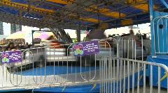 Fairground midway kids rides, pan Stock Footage