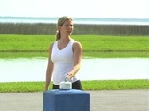 Stock Video Footage of Beautiful Blonde Drinks from an Outdoor Water Fountain