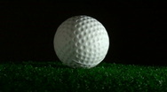 Stock Video Footage of Golf ball in grass rotates