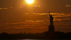 Stock Video Footage of Time lapse - Sunset behind Statue of Liberty