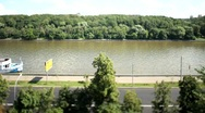 Timelapse ships in river near forest and road Stock Footage