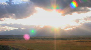 Grand Tetons Sun Flare Pan Stock Footage