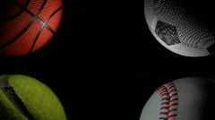 Sports balls against black loop - HD Stock Footage