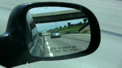 Objects in Mirror May Be Closer Than They Appear Stock Footage