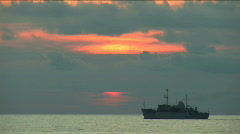 Beautiful sunset on the black sea. During a sunset the boat floats - stock footage