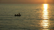 Stock Video Footage of Beautiful sunset on the black sea. During a sunset the boat floats