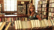Student Locates a Book 780 Stock Footage