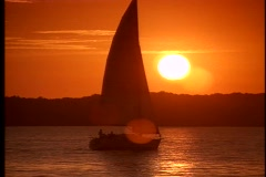 Sailboat at sunset 3 Stock Footage