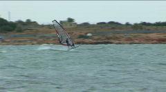 Sailboard in a sea bay. Seagull accompanies the sportsman Stock Footage