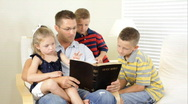 Stock Video Footage of dad reading bible to kids