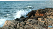 Stock Video Footage of Strong wind breaks waves about coast stones