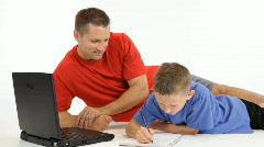 dad helping with homework - stock footage