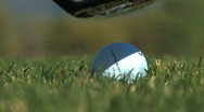 Hitting Golf Ball with Wood in Grass Stock Footage