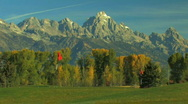 Golf Course with Grand Tetons in Background Zoom Out Stock Footage