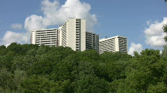 White apartments on green hillside. Timelapse. Stock Footage