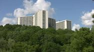 White apartments on green hillside. Timelapse. Stock Footage