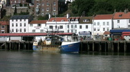 Stock Video Footage of Fishing boat at the Fish Market at the port of Whitby North Yorkshire