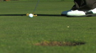 Making a Long Golf Putt Stock Footage