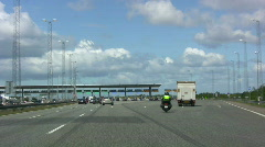 Entering the toll booth at the Great Belt Bridge, Denmark Stock Footage