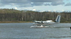 Twin Otter aircraft on floats taxis from shore to takeoff position Stock Footage