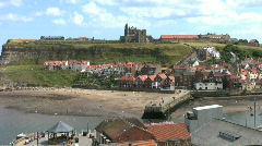 Zoom into the view of Whitby harbor North Yorkshire England Stock Footage