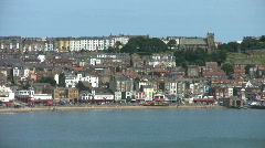 Pan along the south bay to the castle and harbour at Scarborough North Yorkshire Stock Footage