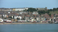 Stock Video Footage of Pan along the south bay to the castle and harbour at Scarborough North Yorkshire