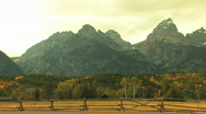 Stock Video Footage of Grand Tetons Pan with Fence